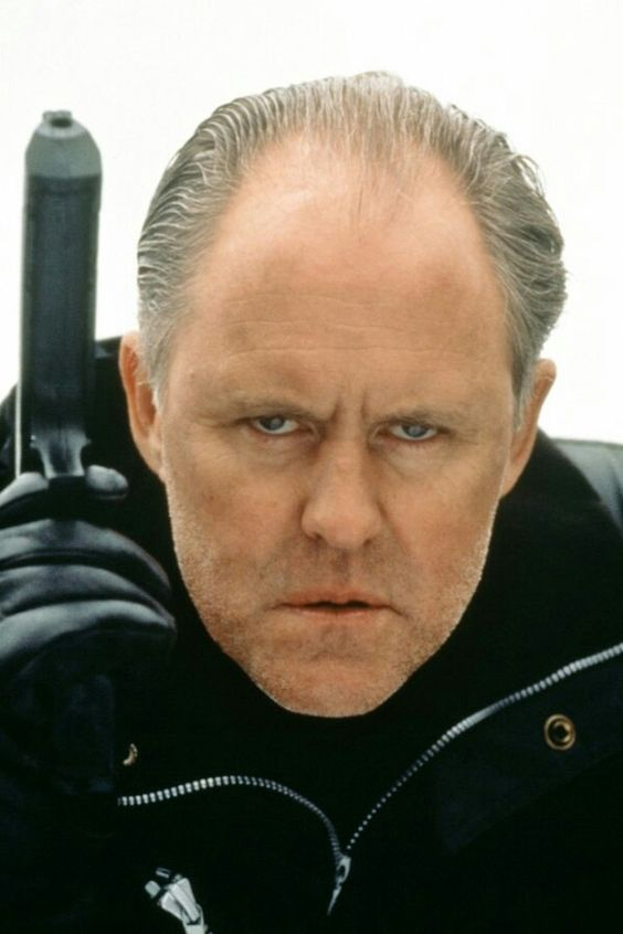 """John Lithgow is Eric Qualen in Renny Harlin's """"Cliffhanger"""" (USA,1993).."""