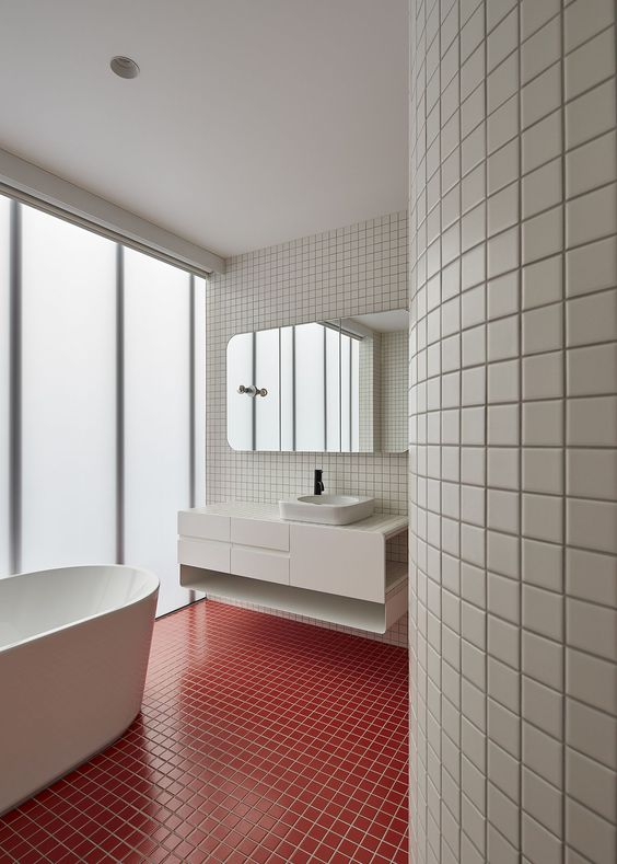 Bright red tiles for the floor in the modern white bathroom