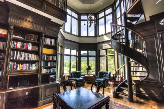 Two story home office / library with spiral staircase.