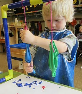Udder painting - balloons with a pin hole filled with paint - funny and good for grip