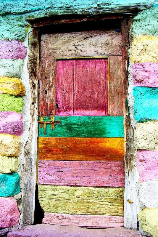 Rustic colorful door in pastel stripes!!! Bebe'!!! Goes well with the pastel rainbow hues of the stone!!!!