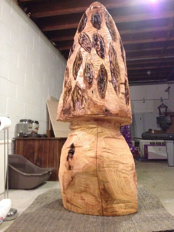 First chainsaw carved morel mushroom with second coat of