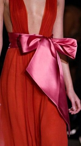 Red dress, pink bow. She needs some coverage, but otherwise, love this look. I've always loved red with pink and have never understood why people claim they don't go together.