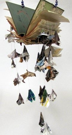 What a cool way to use a book!    Wouldn't that be cool to hang up in your room?: