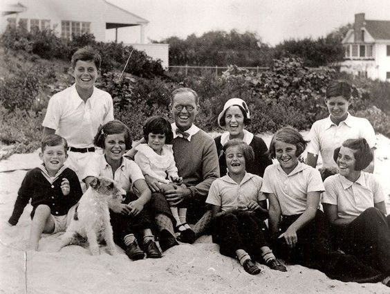 1931 KENNEDY FAMILY PHOTO.    PICTURED LEFT TO RIGHT: BOBBY, JACK, EUNICE, JEAN, JOSEPH SR., ROSE WITH PAT IN FRONT OF HER, KATHLEEN, JOE JUNIOR, & ROSEMARY.    BUDDY IS THE TERRIER.