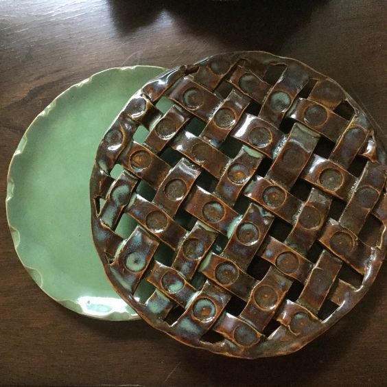 A complimentary pair of stoneware plates... Amaco glazes...