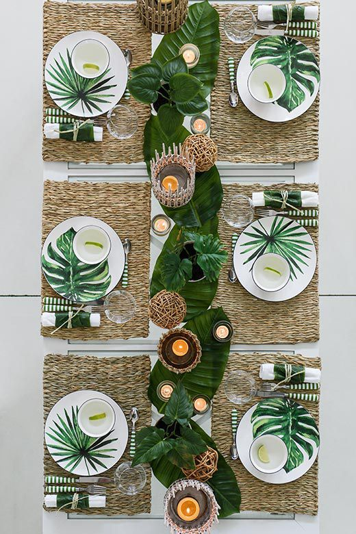 Tropical wedding reception table decor place setting tablescapes and plates | how to use greenery tropical leaves to decorate wedding table. SAVE this gorgeous inspiration table>>