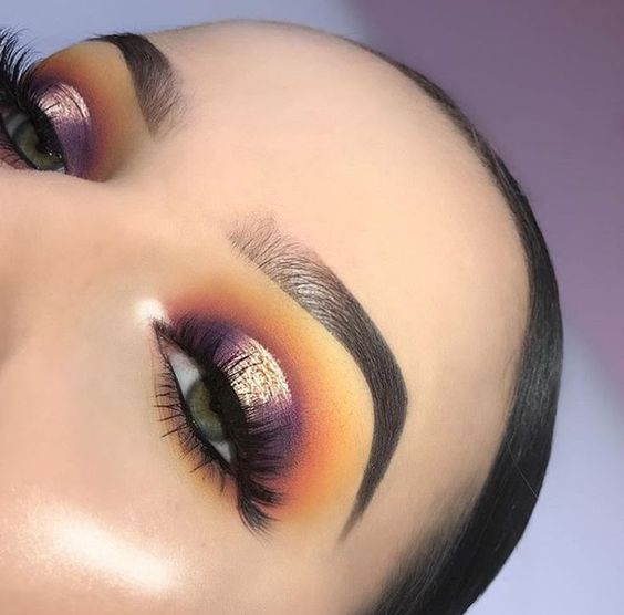 purple plum halo eye with orange and yellow cut crease glam look