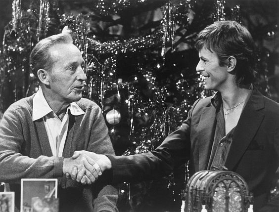 Bing Crosby and David Bowie shake hands during the taping of the