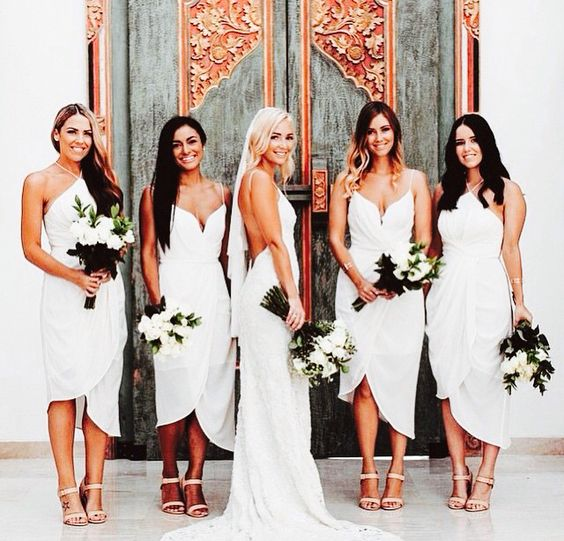 i actually love the idea of the bridesmaids also wearing white. Kim Kardashian did it, and it looked chic and modern!