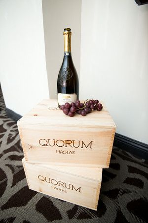 Crates and wine bottles with real grapes to add to the wine theme.