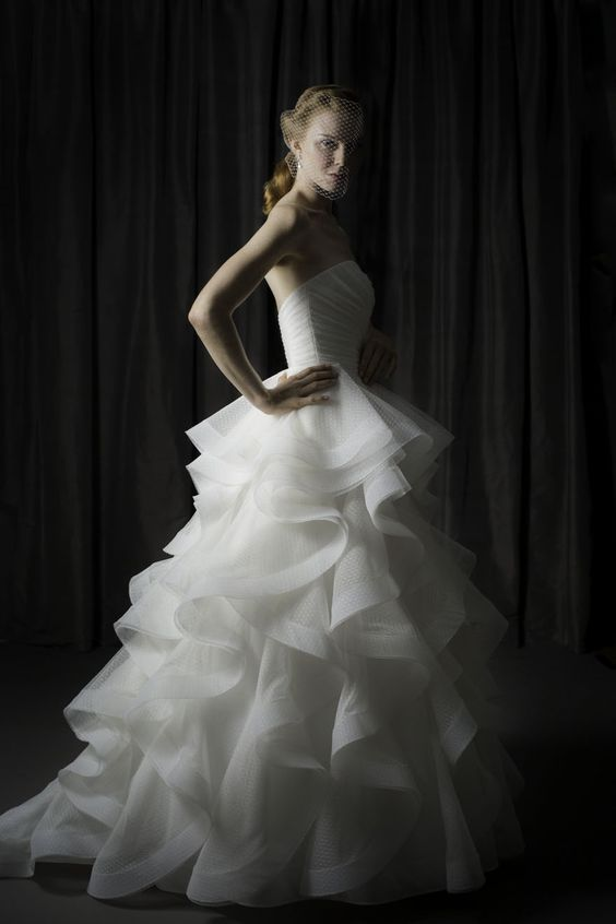 """Judd Waddell """"Carly."""" Point d'esprit gown with draped bodice and horsehair-trimmed cascades."""