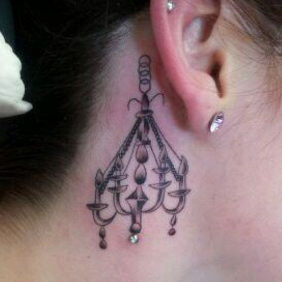 I like the idea of a chandelier tattoo with a dermal in it. It's a unique idea. I'm just not a fan of this placement.
