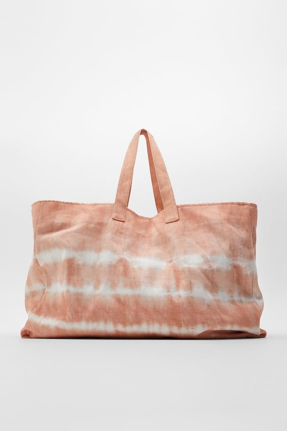 Large Bucket Bag Available In Different Colors. Tie-Dye Print Exterior. Shoulder Straps. Lined Interior With Pocket. Magnet And Hook Closure. Height X Length X Width: 14 X 21.5 X 7.9 Inches (35.5 X 54.5 X 20 Cm)