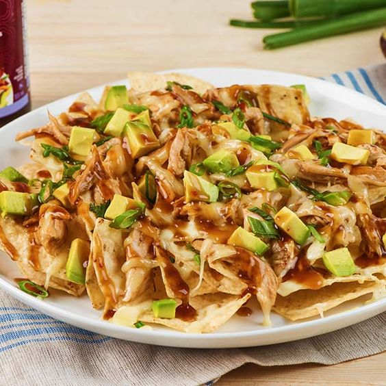 Chicken Teriyaki Nachos - Preheat oven to 400°F (200°C). In bowl, toss chicken with VH® Teriyaki Sauce until well coated. Lay half of the tortilla chips on large parchment paper¬–lined pizza pan or baking sheet. Top evenly with half of the chicken and cheese. Repeat layers. Bake for 8 to 10 minutes or until cheese is melted. Sprinkle with … Continue reading Chicken Teriyaki Nachos →