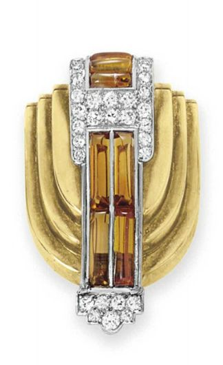 A DIAMOND, CITRINE AND GOLD BROOCH, BY CARTIER   Designed as a sculpted gold shield-shaped plaque set with cabochon citrines, decorated with circular and single-cut diamond detail, mounted in gold and platinum  Signed Cartier, nos. 9588 and 6190