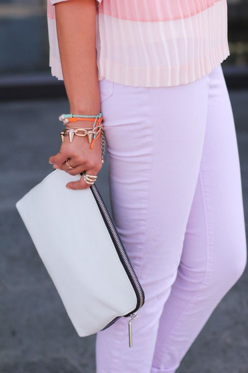 Pastels + pleats = pretty!! I love the little arm party too.