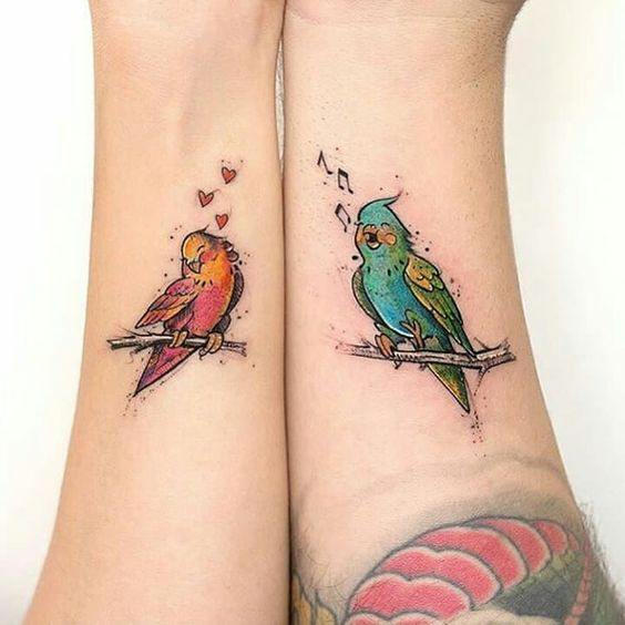 Lovebird tattoos for couples- 27 matching tattoos for couples that last longer than a ring - OurMindfulLife.com