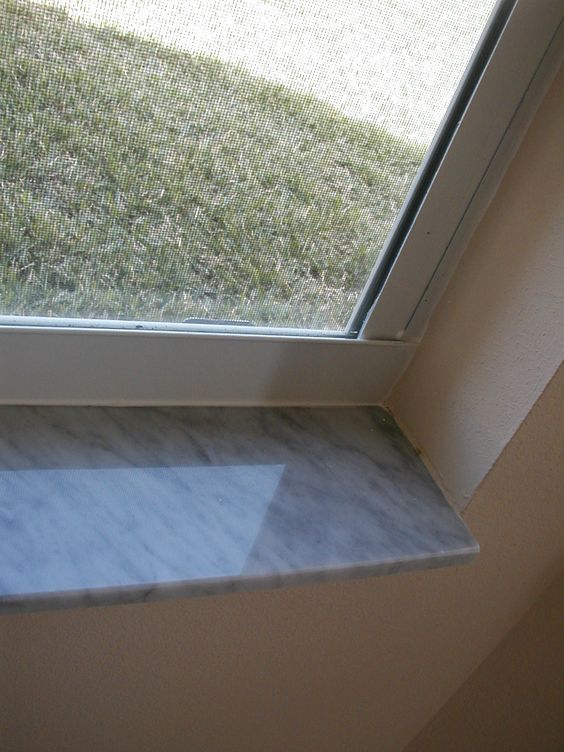 Marble Window Sills. My grandparents had these in their Florida home. Doesn't always work with complicated moldings, but on a simple window without moldings these add so much class, plus are water resistant