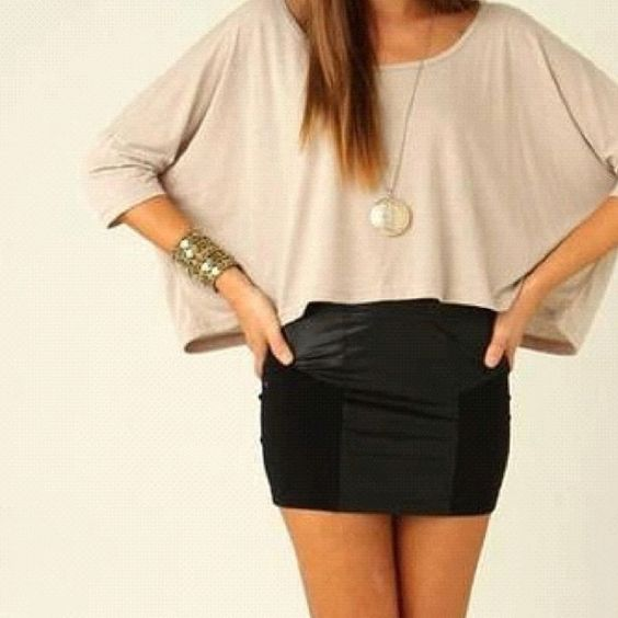 loose top and a short pencil skirt