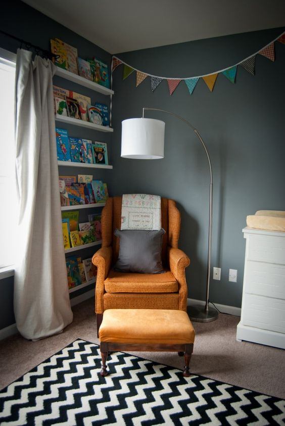 Nursing/Reading Corner in the Nursery - love this colorful, eclectic nursery!