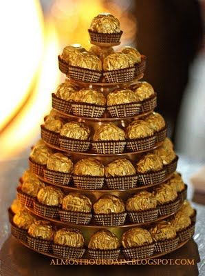 Ferrero Rocher pyramid - lidl 4.00 for 12.  pyramid of 55 = 5 boxes