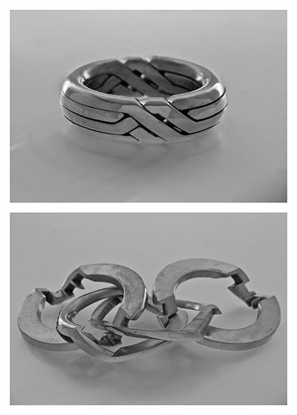 Yael Friedman puzzle rings - http://www.yayo-design.com/puzzles_lb