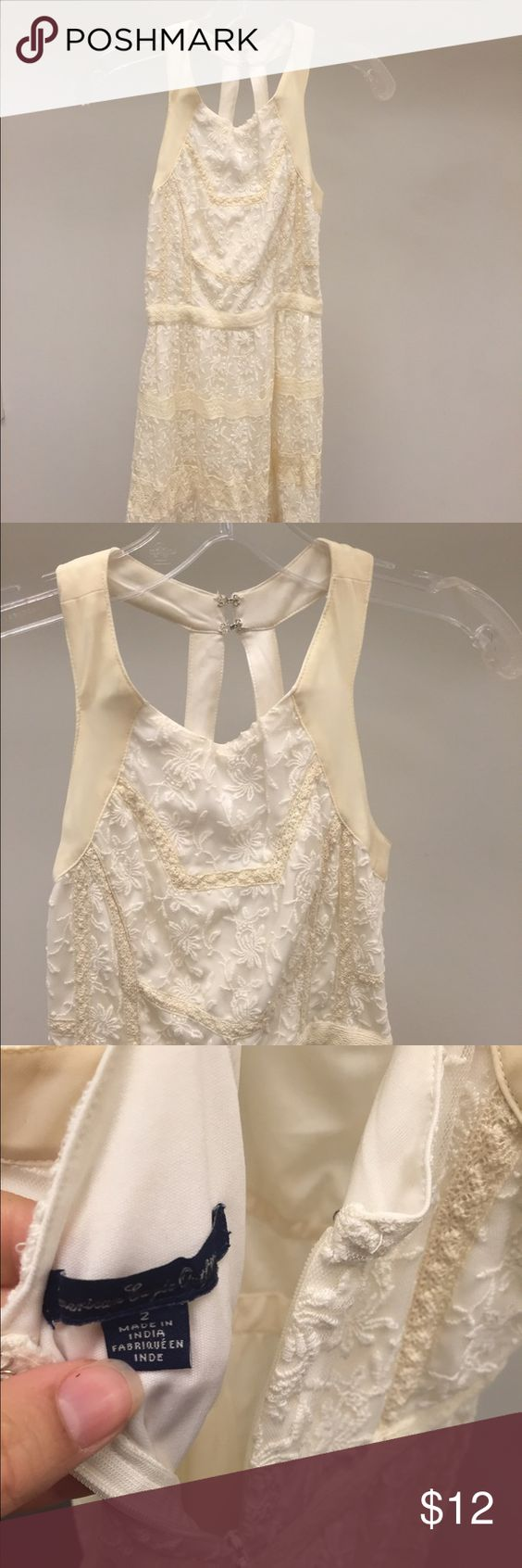 American Eagle Lace Dress Gorgeous cream and tan lace dress from American Eagle. Pretty neckline and back. It has been worn but has no major flaws or damage. #ae #americaneagle #neutral #lace #dress #pretty #femimine American Eagle Outfitters Dresses Mini