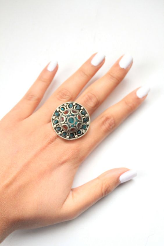 Check out this item in my Etsy shop https://www.etsy.com/listing/246099668/vintage-tribal-silver-ring-boho