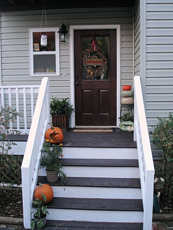 I like the dark stain porch with the white risers great for Stained front porch