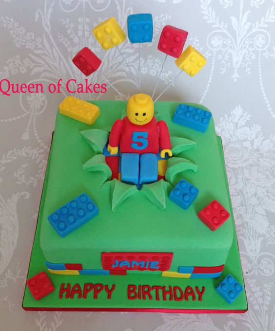 Bright Lego theme birthday cake with fondant Lego man and Lego bricks. www.Queenofcakes.org.uk