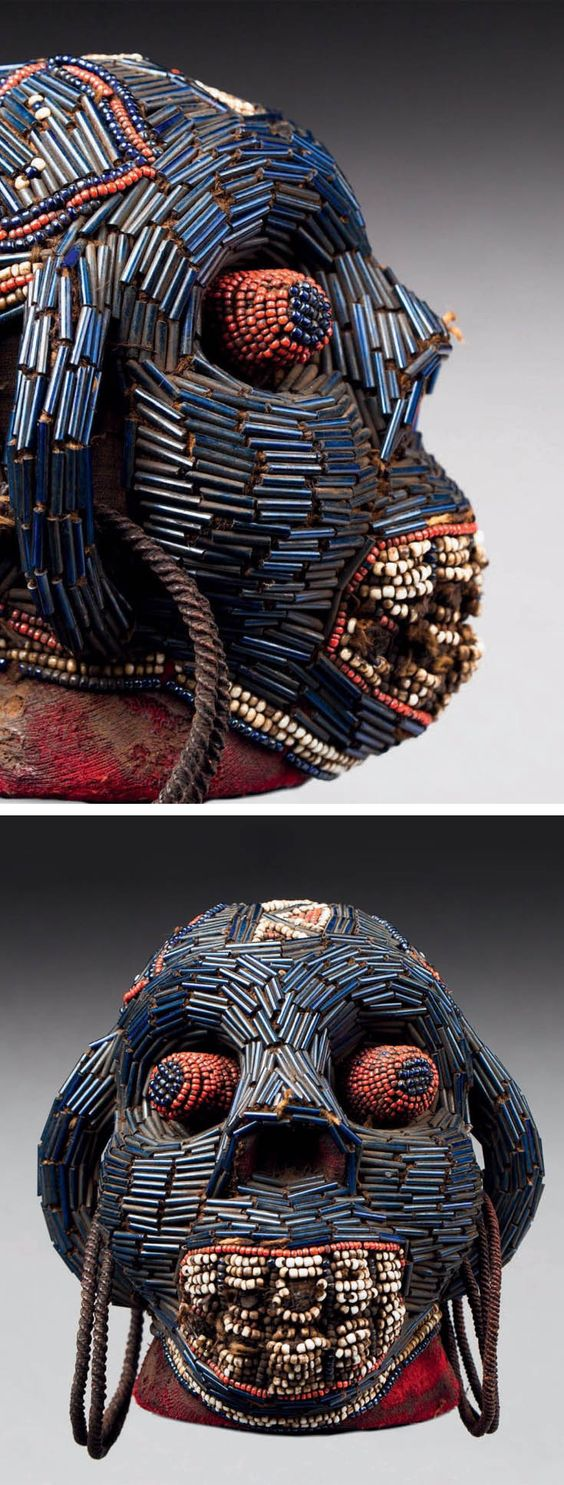 Africa | Ritual or reliquary head from the Bamileke people of Cameroon | Covered with imported red cloth, glass beads, metal | ca. late 19th to early 20th century