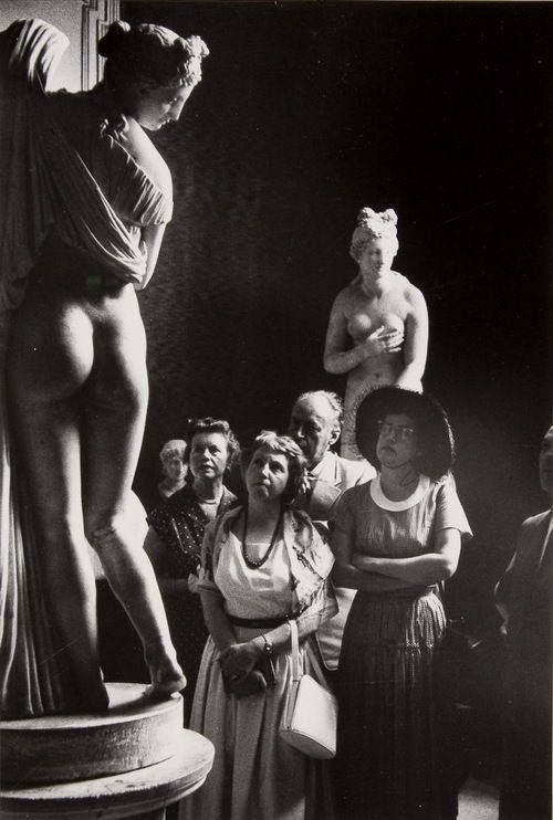 Italy. Visitors observing The Venus Callipyge at the National Archaeological Museum, Naples, 1952 // Photo by David Seymour: