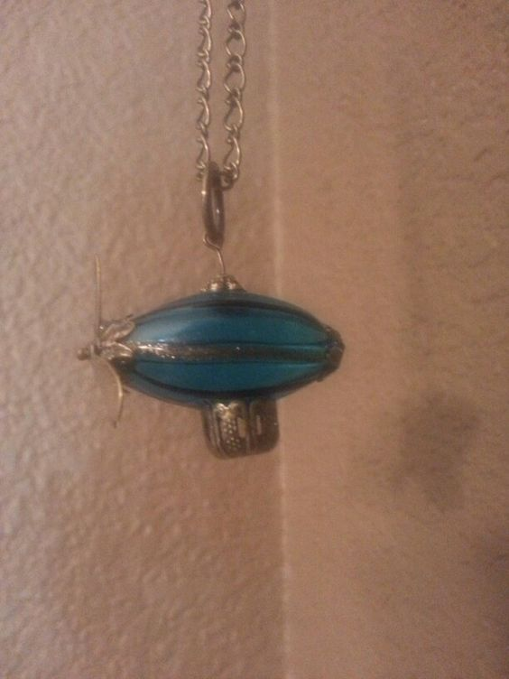 Airship necklace $20 www.ScarletNRGsBaubles.com. Also in green and a red pin