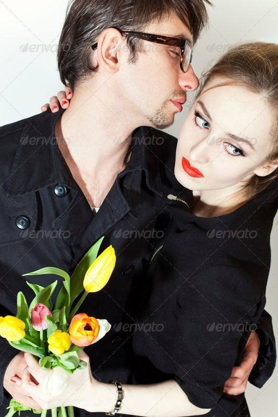loving couple with bouquet of tulips (blond, bouquet, couple, double, dress, flowers, gift, girl, glasses, guy, jeans, love, man, pair, people, portrait, red, stylish, tulips, two, woman, young)
