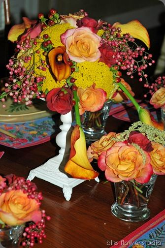yarrow adds a shot of yellow to a centerpiece of 'Gypsy Curiosa' roses, 'Terra Cotta' roses, 'Flame' callas and pepperberries…