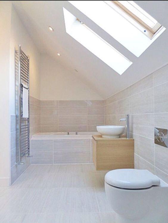 Neutral beige bathroom, fully tiled around bath