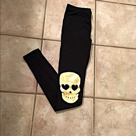 So cute! NWOT gold skull knee patch leggings! Just darling- jet black with shiny gold skull patches on the knees!!  See you next monday Pants Leggings