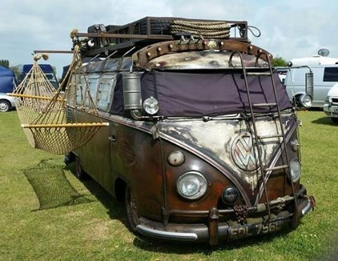 Steampunk Volkswagen van look, with a hammock on the side, and a roof mount fit for a caravan across the desert.