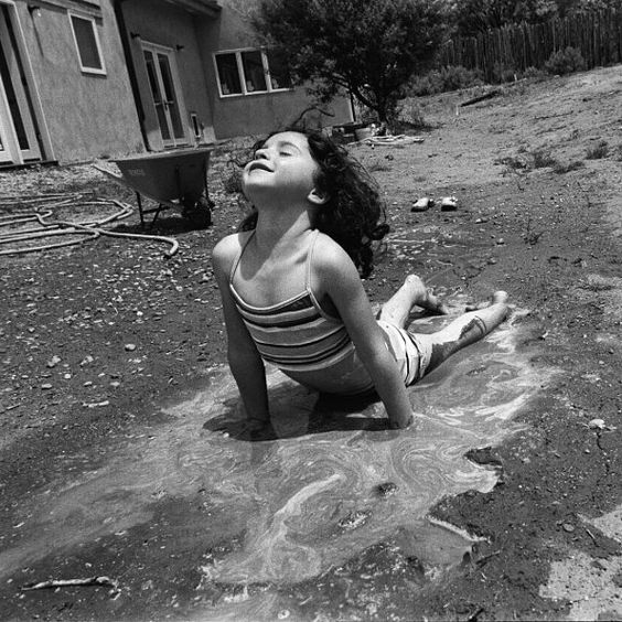 """""""My daughter missing the beach decides to make a mud bath to swim in"""" photographer Dorie Hagler (@doriehaglerphotography) writes from #Taos #NewMexico. To submit your images for consideration on our feed follow @childhoodeveryday and tag your photos #childhoodeveryday. // #portrait #portraitphotography #portraits #documentary #documentaryphotography #landscape #blackandwhite #blackandwhiteisworththefight #monochrome #contemporaryphotography #artphotography #contemporaryphotography"""