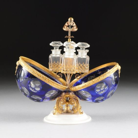 A CONTINENTAL COBALT BLUE CUT TO CLEAR CRYSTAL EGG c.1880 the inside with scent flasks