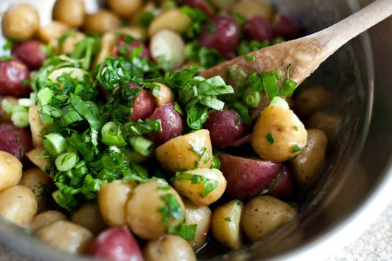 french potato salad with dijon, champagne vinaigrette + parsley.