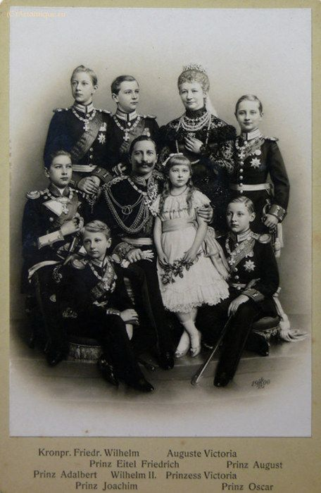 Augusta and Wilhelm with their complete family. Back row, left to right: Crown Prince Friedrich Wilhelm, Prince Eitel-Friedrich, Empress Augusta, and Prince August Wilhelm. Seated: Prince Adalbert, the Kaiser, Princess Viktoria Luise, the only girl, and Prince Oskar. In front: Prince Joachim, his mother's favorite.: