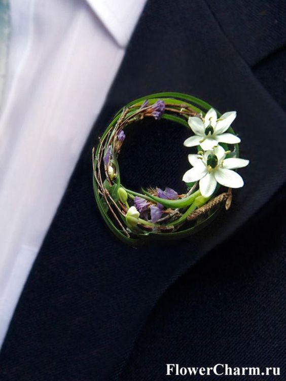 Pretty contemporary boutonniere with white ornithogalum and decorative grasses by http://www.flowercharm.ru/services/wedding/butonerka.html