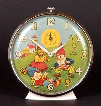 Superb Noddy collectable produced in ivory painted metal with chrome surround, the face features Mrs Tubby and Big Ears attempting to wake the sleeping Noddy. As the clock ticks, Noddys head rocks gently.