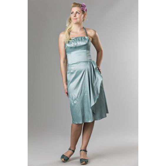 Delizioso abito estivo da cockail, fresco nel suo color menta e ricco di dettagli. La gonna a pareo è arricchita da una fascia drappeggiata, che rende l'abito unico e favoloso.