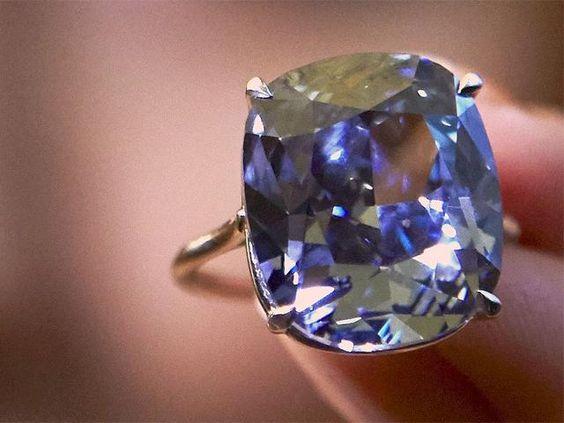 Slideshow : Blue Moon Diamond sold for world record $48.5 million - Rare 12.03-carat Blue Moon Diamond sold for world record $48.5 million at auction - The Economic Times