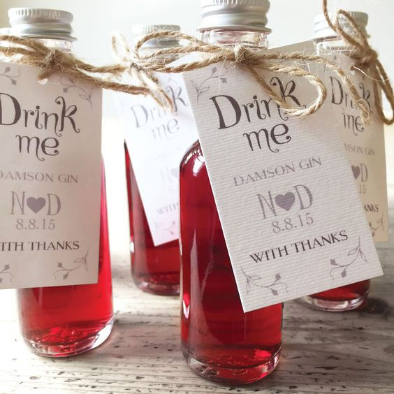 'Drink Me' Alice in Wonderland inspired Wedding Favour Labels. Simple, white and silver wedding favour tags. Can be customised with various colours and personalised with the details of your special day. Perfect for miniature bottles on your wedding table.