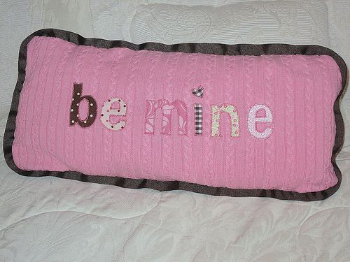 Sweater pillow with applique