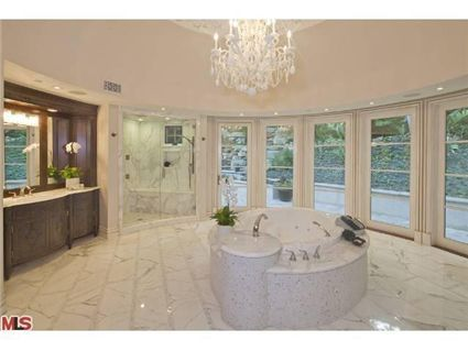 Marble bathroom. If this was mine I would probably add curtains.
